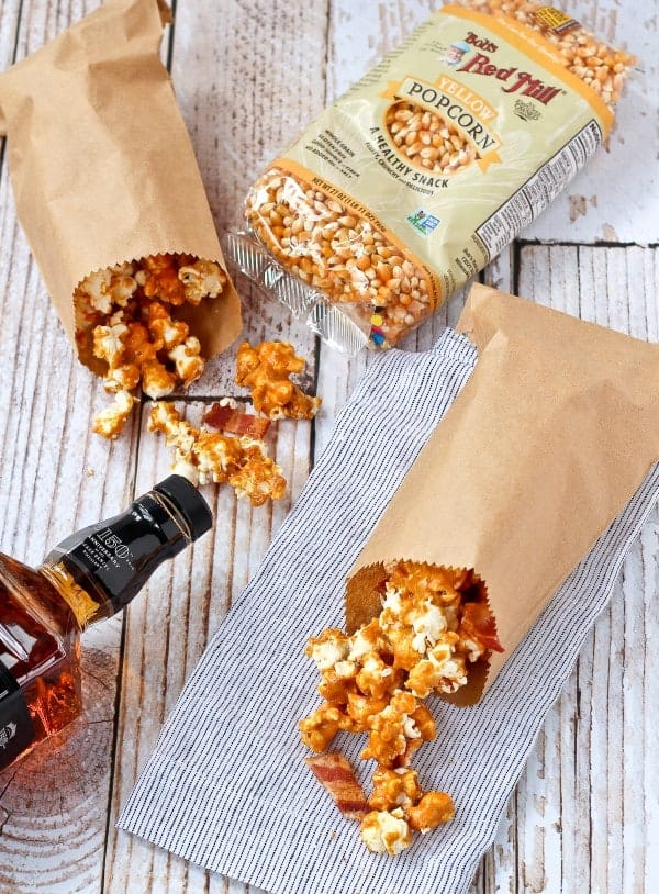 Take your caramel corn game to the next level with this homemade caramel corn with bourbon and bacon. You'll love the salty sweet combination of this irresistible snack. Get the easy recipe on RachelCooks.com!