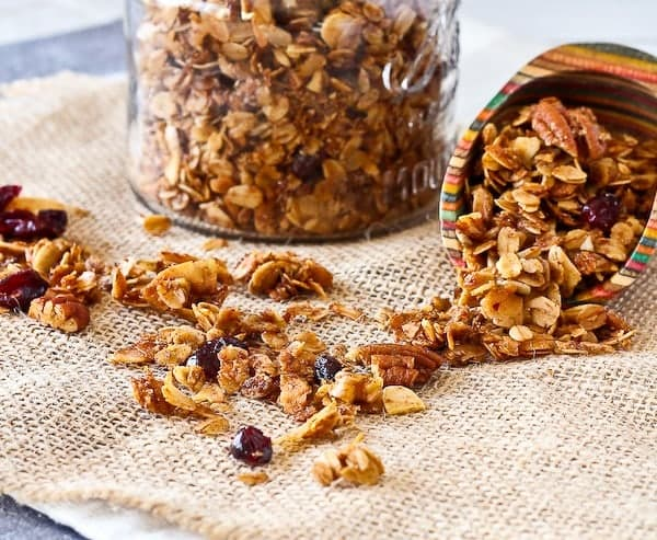 This easy granola recipe with pecans and cranberries will become your go-to granola recipe - you won't ever be buying granola from the store again. This is way too easy!