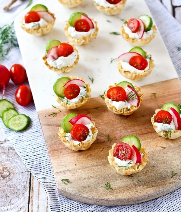 These spring herb cream cheese appetizer cups scream spring and are easy to make - they come together in minutes and are a stunning addition to any appetizer spread.