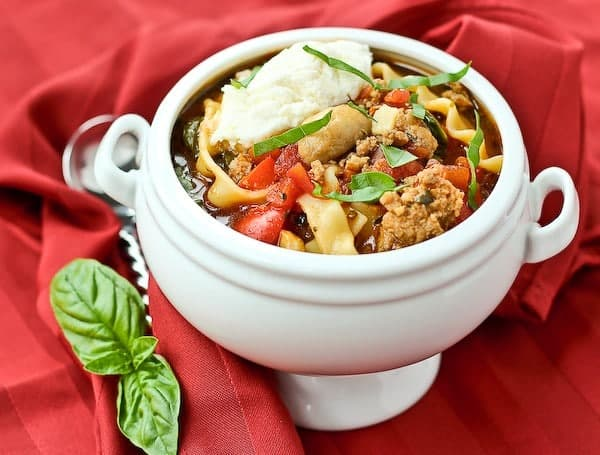 Love lasagna but hate all those layers? You're not alone. You're going to adore this lasagna soup recipe. It gives you the comfort that only lasagna can...but without the stress. Get the easy soup recipe on RachelCooks.com!