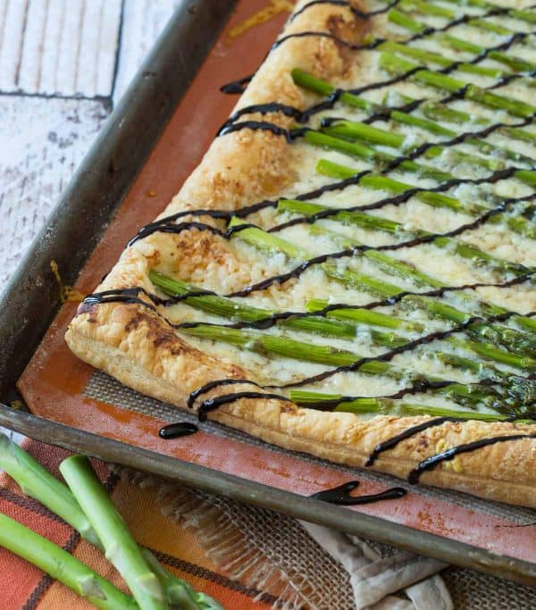 Perfect for spring, this Asparagus Gruyère Tart is a show-stopping addition to any brunch or appetizer table. You won't believe how easy it is to make!