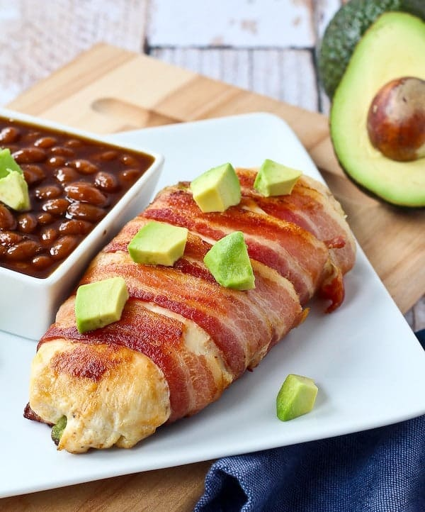 Bacon wrapped chicken breast stuffed with avocado and cheddar...do I really need to say more than that? This mouthwatering combination is served up on the grill - this recipe will become a summertime favorite! Get the recipe on RachelCooks.com!
