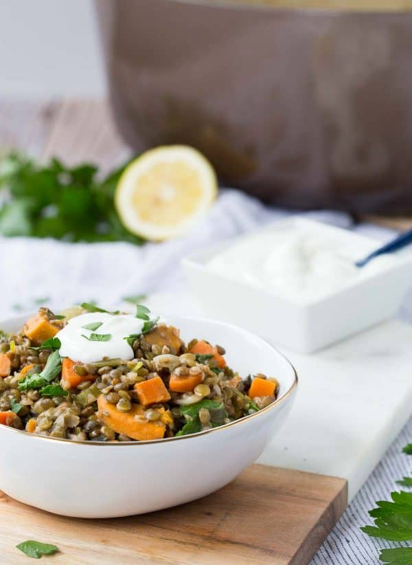 One Pot Green Lentils with Sweet Potatoes and Kale are a hearty vegetarian meal - easy to make and packed with nutrition and flavor, these are sure to become a favorite! Get the vegetarian recipe on RachelCooks.com!