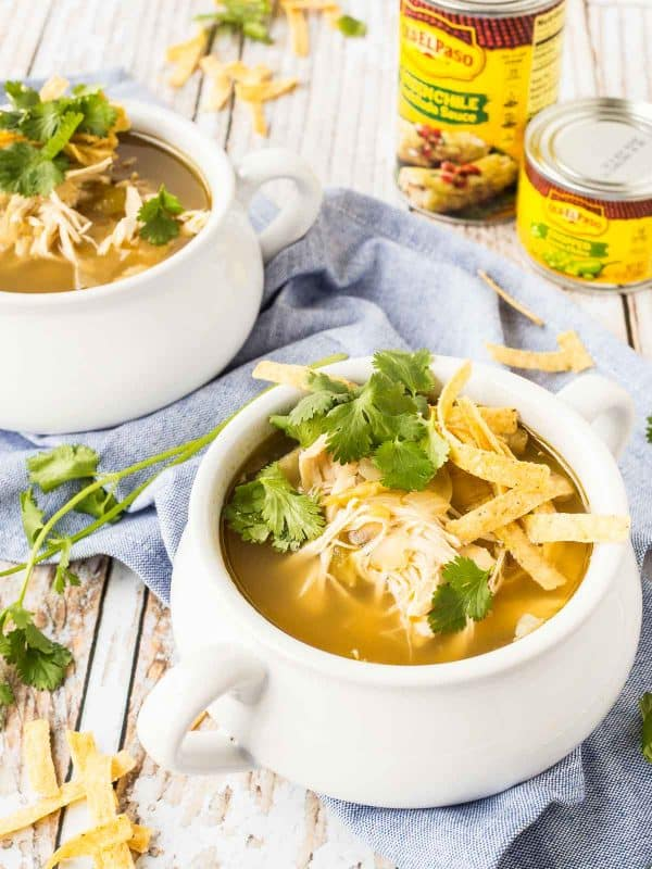 Switch up the chicken soup routine with this easy and flavorful slow cooker 5 ingredient enchilada verde soup. Made in the slow cooker! Get the easy recipe on RachelCooks.com!