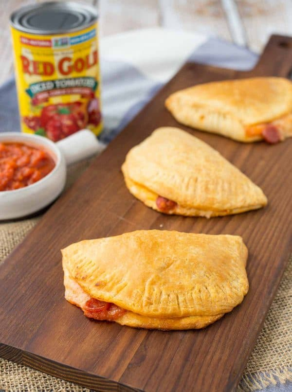 Homemade Hot Pockets are a fun alternative to pizza night and they also make for a fun surprise in lunch boxes. Get the kids involved in making this easy recipe, too! Get the easy recipe on RachelCooks.com!
