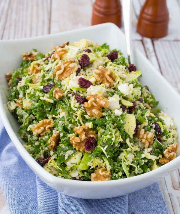 This kale quinoa salad is a healthy and hearty salad that stores well in the fridge, making it perfect for meal prep days. You'll love the crunchy walnuts and sweet, chewy cranberries! Get the salad recipe on RachelCooks.com!