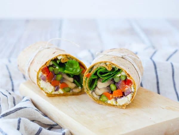 Filling and flavorful, this roasted vegetable wrap is perfect for Meatless Monday or any day! Prep the vegetables on the weekend to make it even easier. Get the easy vegetarian recipe on RachelCooks.com!