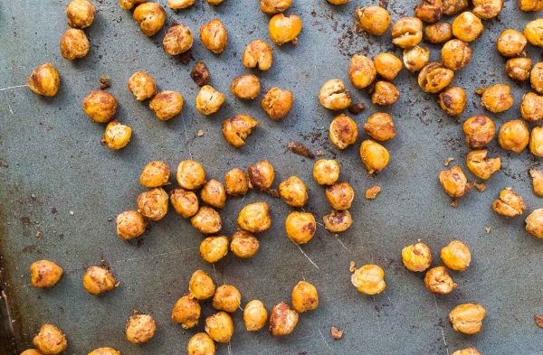 Cinnamon Roasted Chickpeas are a healthy and flavorful snack -- you'll find these are the perfect thing to crush salty and sweet cravings and keep you full! Get the easy snack recipe on RachelCooks.com!