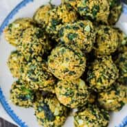 Spinach Balls are great hot out of the oven but are also great as they cool to room temperature, making them a perfect appetizer! Always a huge hit! Get the healthier version of this appetizer recipe on RachelCooks.com!