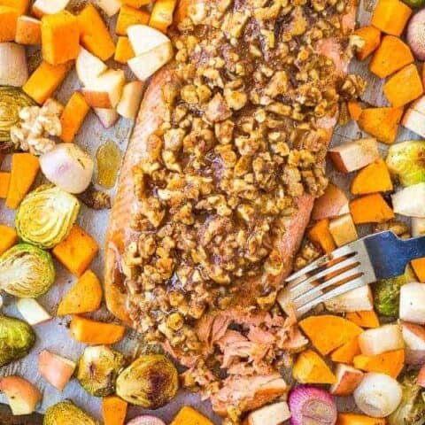 This Walnut Crusted Salmon Sheet Pan Dinner is going to be your next dinner home run. It's full of fall flavors and super easy for a busy weeknight -- it will be your new go-to dinner! Get the easy sheet pan dinner recipe on RachelCooks.com!