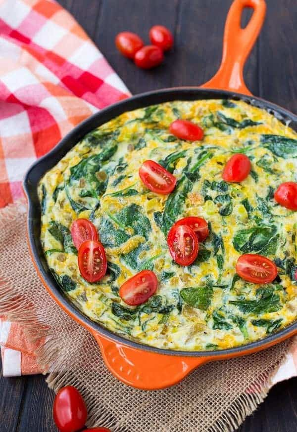 This egg white frittata is loaded with the great flavors of green chiles, scallions, cheese, and spinach. It's a healthy vegetarian start to your day and it's packed with protein! Get the easy recipe on RachelCooks.com!