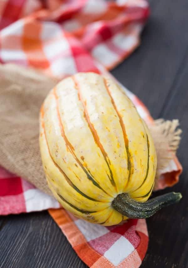 Learn how to cook delicata squash with this easy roasting method! Spoiler alert: No peeling necessary!  Get the easy method on RachelCooks.com!