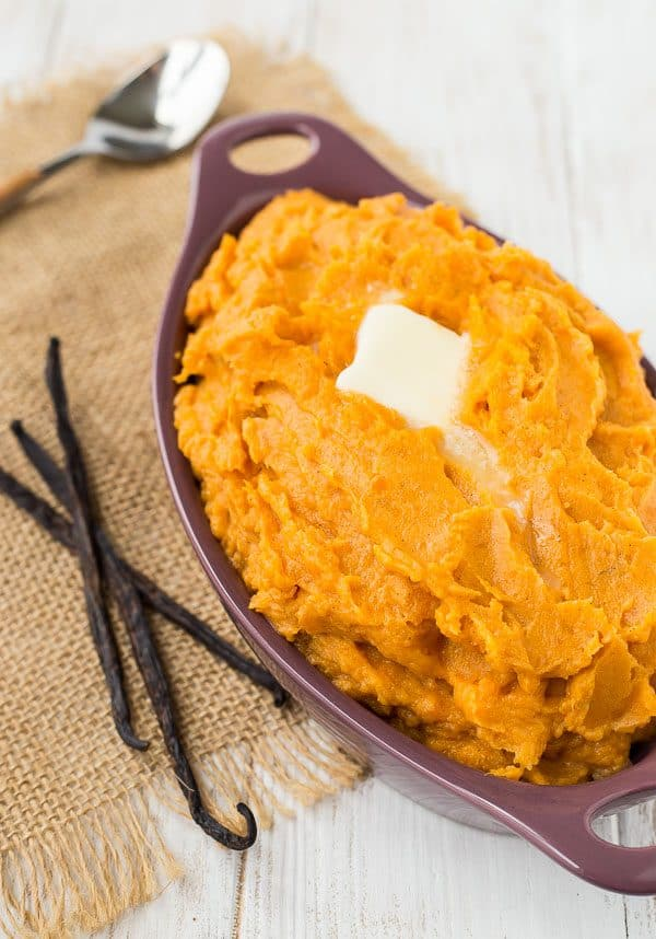 Creamy and sweet, these vanilla bean mashed sweet potatoes taste like dessert! They're so easy to make and will become a quick favorite! Get the recipe on RachelCooks.com!