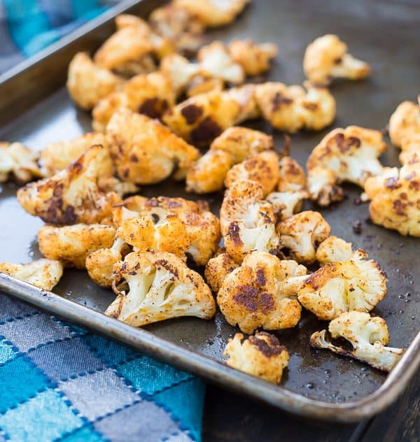 Roasted Cauliflower with Chili Powder is absolutely perfect on its own but it's also an ideal addition to salads and burrito bowls. You might even find yourself reaching for the chili powder every time you roast cauliflower! Get the recipe on RachelCooks.com!
