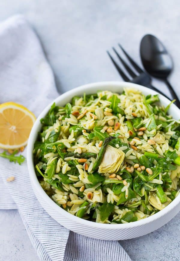 image of spring orzo salad in a bowl with lemon