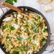image of one pan chicken alfredo recipe with broccoli, wooden spoon