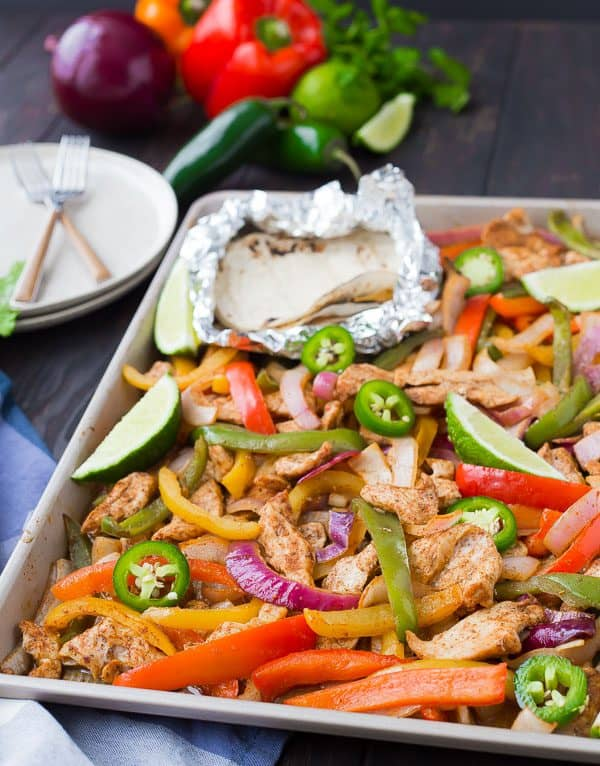 Sheet pan fajitas are great for busy weeknights and also great for bigger crowds! You'll love this easy, hands-off approach to fajitas! This recipe is for chicken fajitas but you'll also find tips for steak, vegetarian, and shrimp fajitas!Get the recipe on RachelCooks.com!