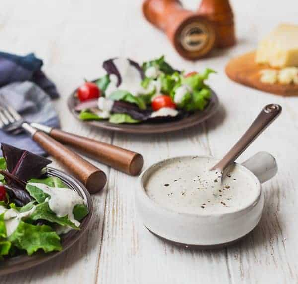 This creamy Parmesan Peppercorn Dressing is the perfect dressing if you love ranch but are looking for something new. It's cheesy with a little spice and it's lightened up with Greek yogurt and buttermilk. You're going to love it!