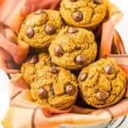 image of pumpkin chocolate chip muffins in a basket with orange towel