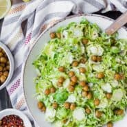 This Brussels Sprouts Salad Recipe with Crispy Chickpeas is simple perfection. It's a fresh and flavorful side dish that's easy to prepare and goes great with fish or chicken.