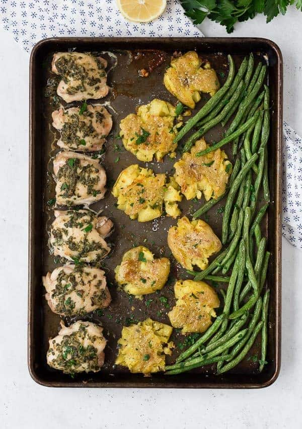 This Whole30 Chicken Thighs sheet pan dinner is an entire flavorful, healthy, and easy to make meal on one single sheet pan! Whole30 or not, make it tonight!