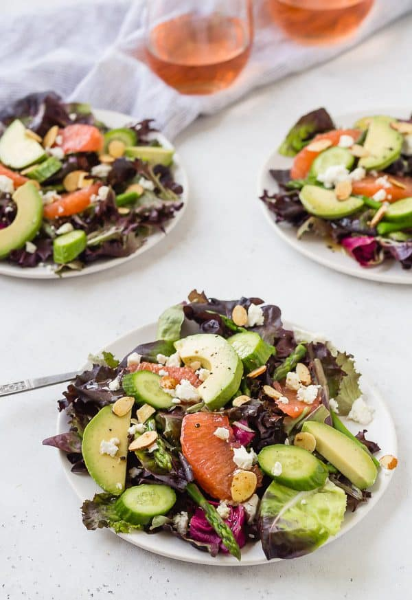 This spring salad is adorned with asparagus, grapefruit, crumbled feta, and creamy avocado. It's topped with a flavorful rosé vinaigrette, making it perfect for brunch or a light summer meal!