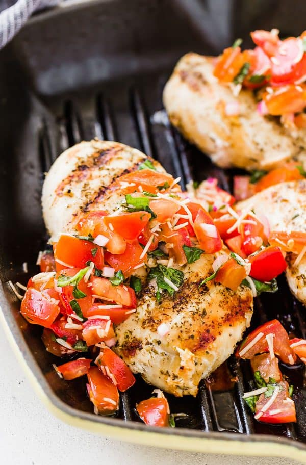 This bruschetta chicken is the perfect summer chicken recipe and it's made in one pan! Browse all the adaptations to make it your own.