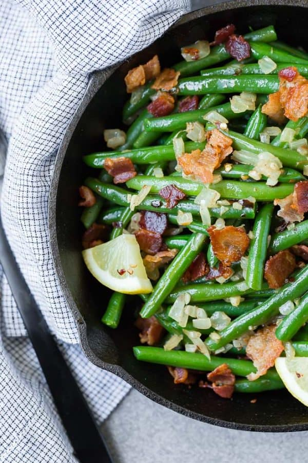 A match made in heaven, these green beans with bacon are completely irresistible. They very well might be your new favorite green bean recipe!