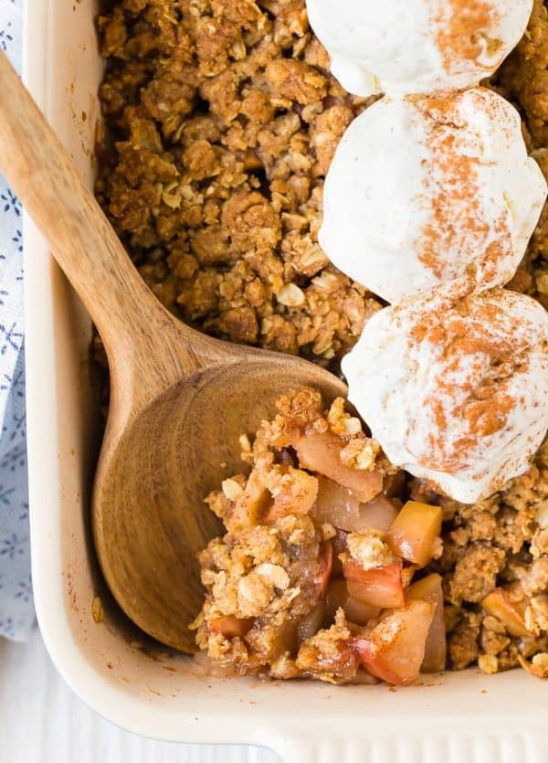 Image of ginger apple crisp recipe. Topped with ice cream.