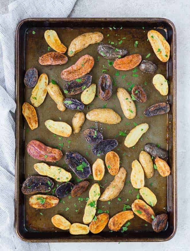 These fun and colorful roasted fingerling potatoes will impress friends and family but taste great any day of the week. And they're so easy to make!