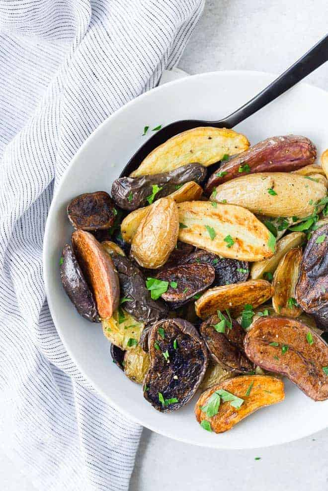 These fun and colorful fingerling potatoes will impress friends and family but taste great any day of the week. And they're so easy to make!