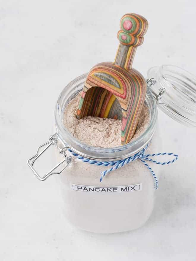 Image of dry pancake mix with a scoop inside jar.