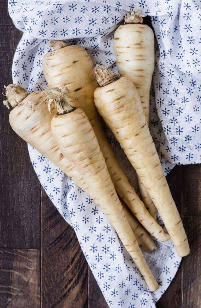 Image of 5 raw, unpeeled parsnips