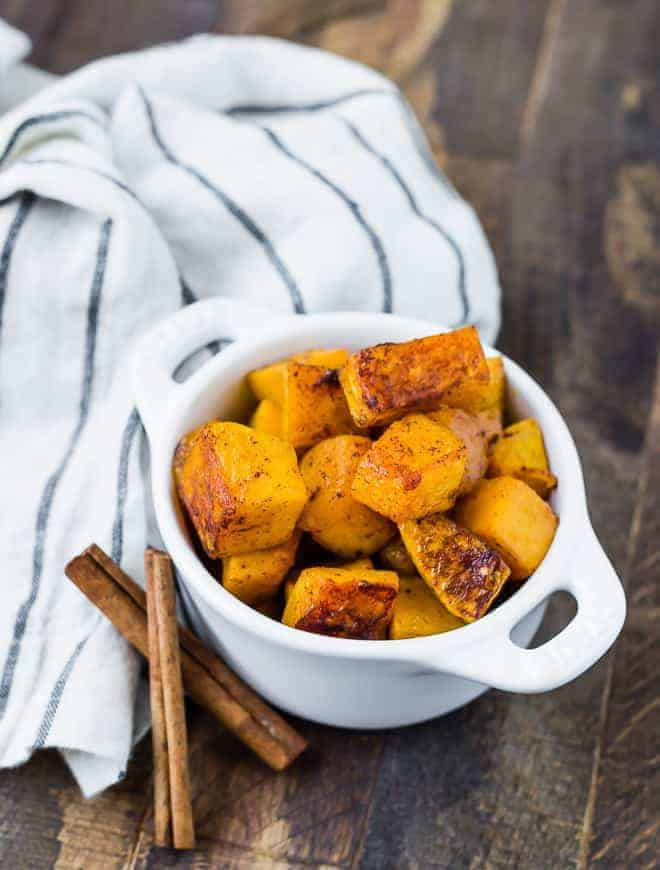 Image of spicy sweet butternut squash in a small white bowl.