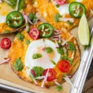 Image of sheet pan breakfast tostada with lots of southwestern toppings.