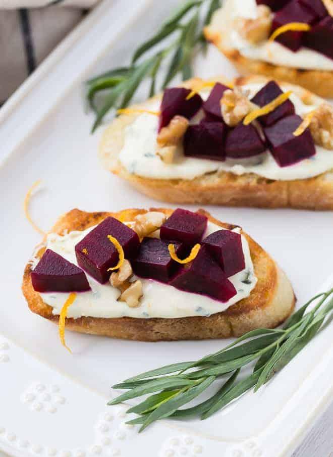 Image of beet crostini, garnished with tarragon.