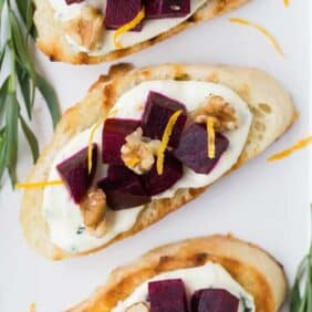 overhead photograph of beets and goat cheese on crostini