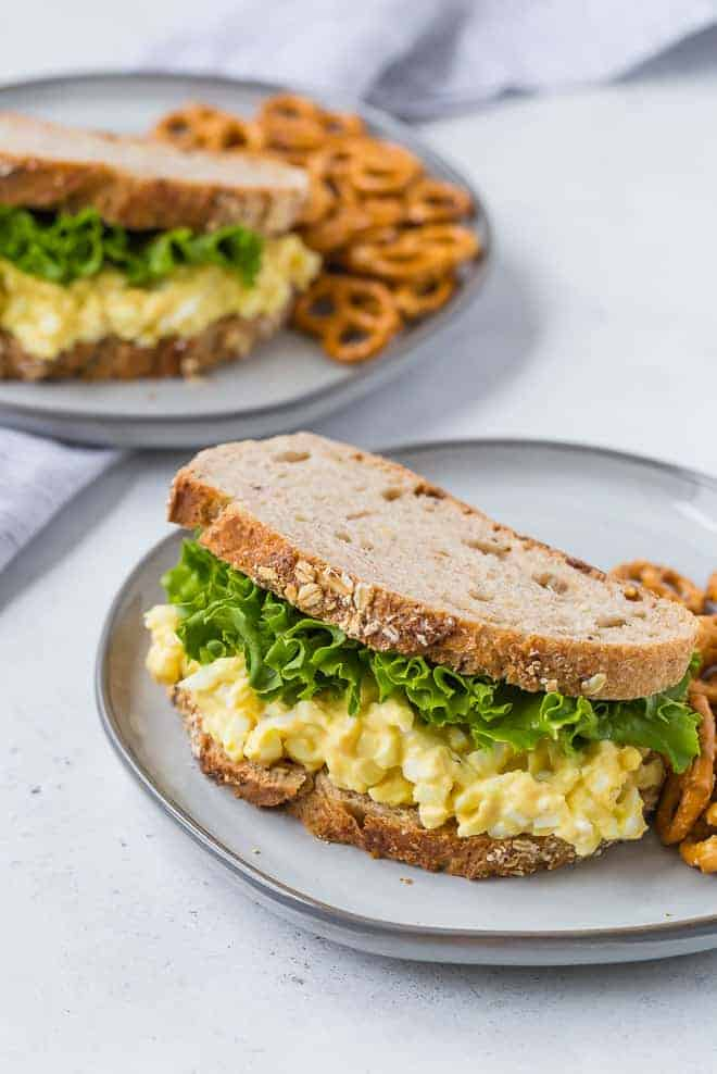 Image of a healthy, hearty egg salad sandwich on a plate.