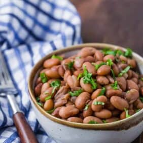 Image of cooked pinto beans made from dried beans using an instant pot.