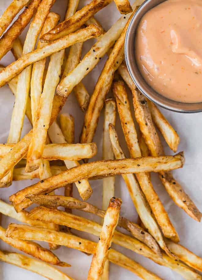 Image of french fries with sauce.