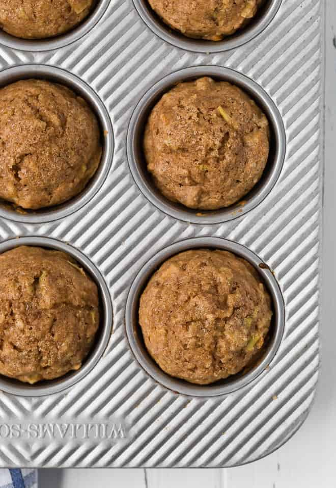 Photograph of healthy whole wheat apple cinnamon muffins in a muffin pan.