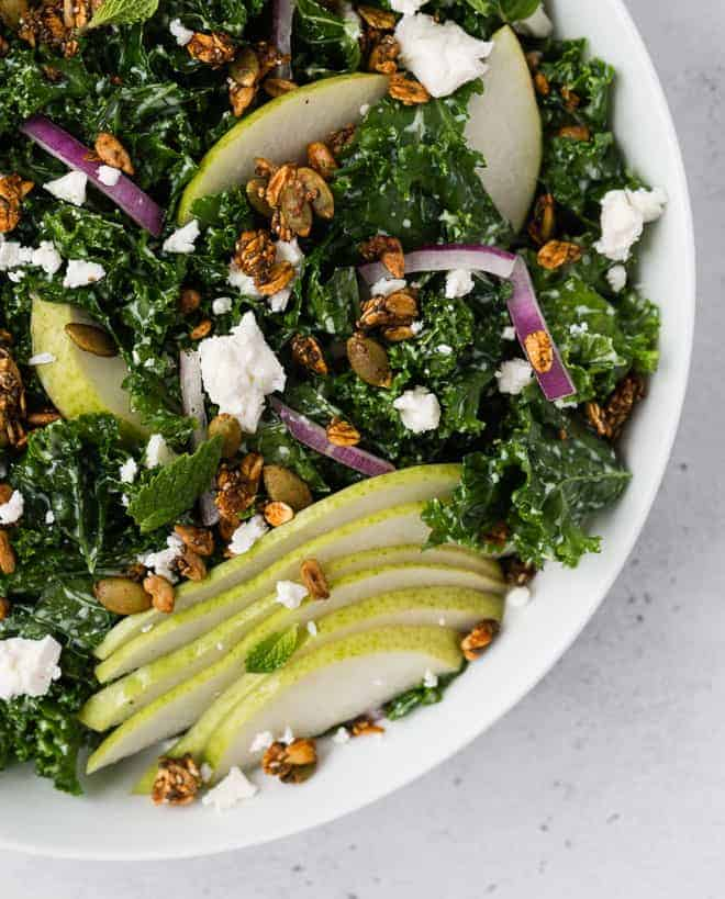 Close up image of kale salad with toppings.