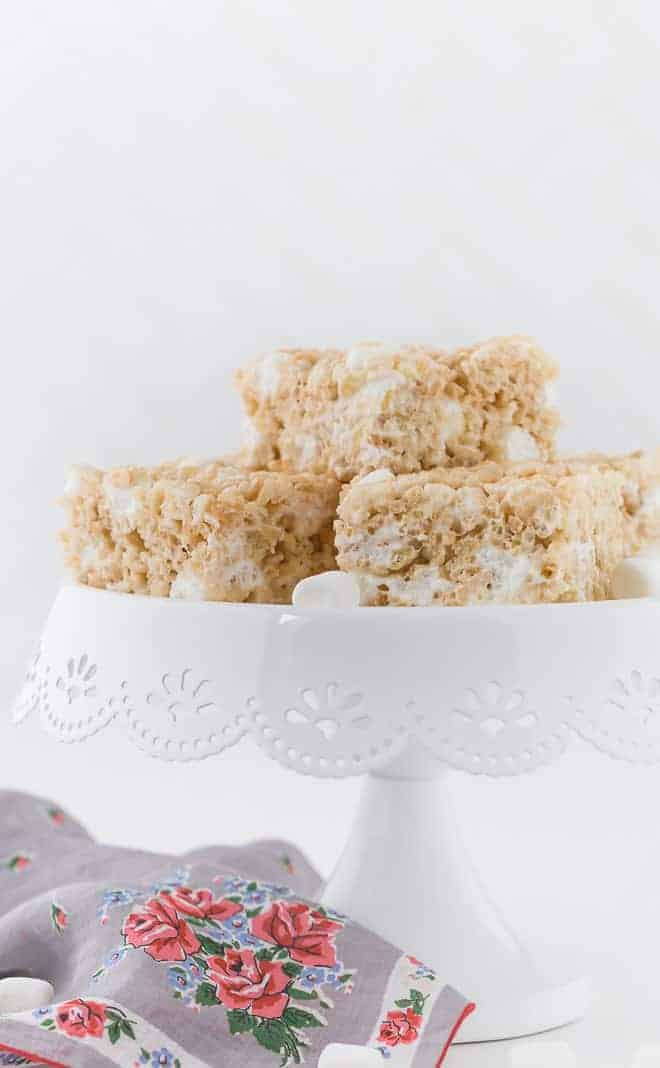 Image of a cake stand topped with a stack of rice krispie treats.