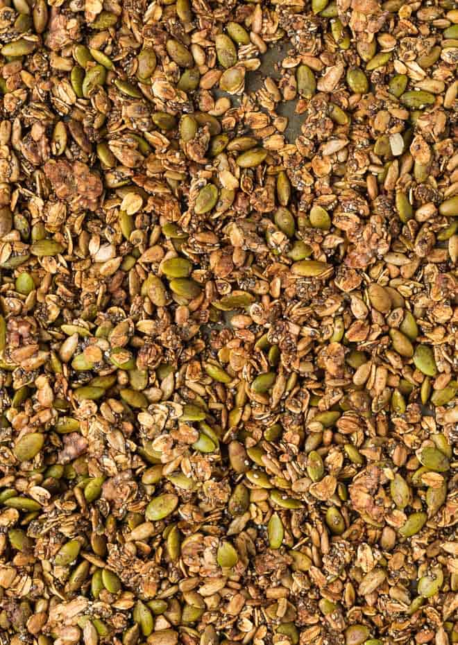 Close up image of nut-free granola made with sunflower seeds, pepitas, oats, and chia seeds.
