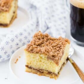 Image of a slice of cinnamon coffee cake with a streusel on top and a cinnamon filling.