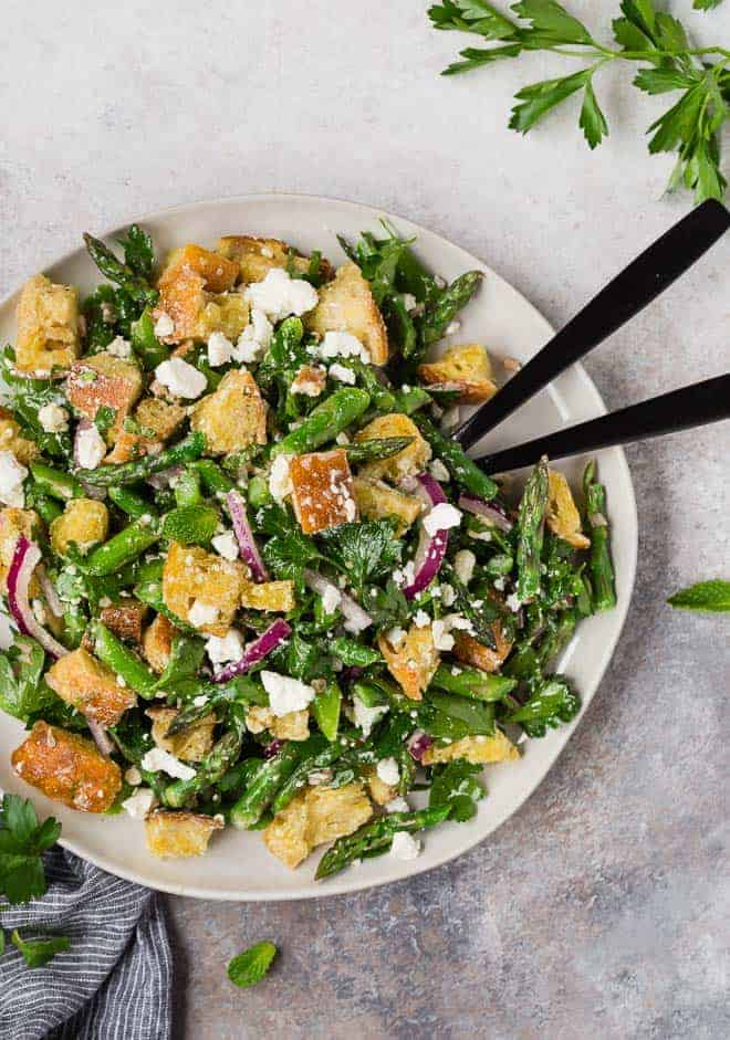Image of a fresh spring panzanella salad made with asparagus.