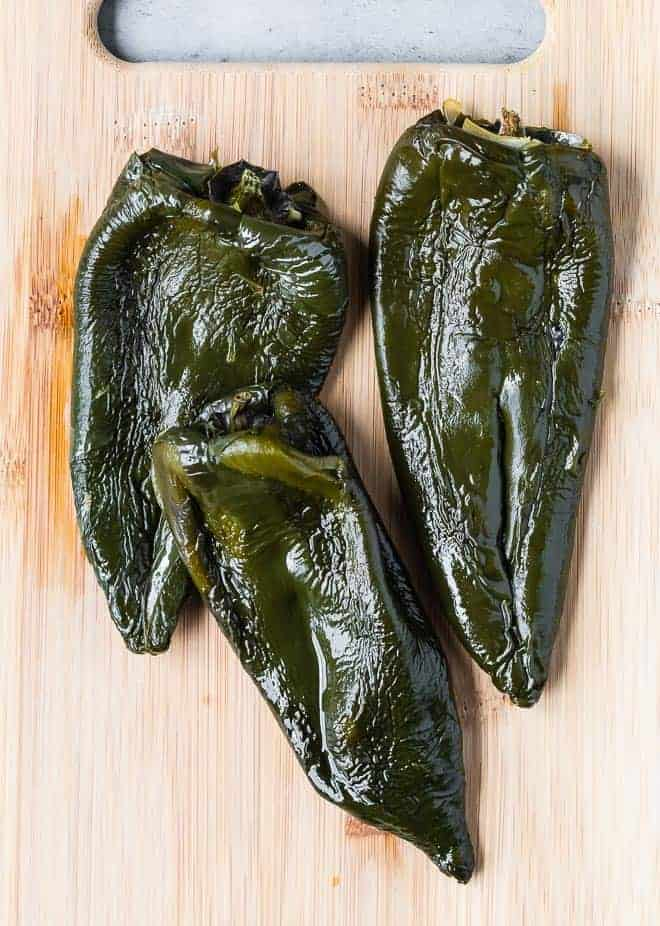 Image of roasted poblano peppers that have been peeled.