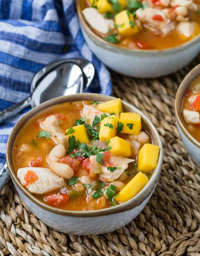 Image of Caribbean chicken chili made with hot sauce and jerk seasonings, topped with fresh mango.