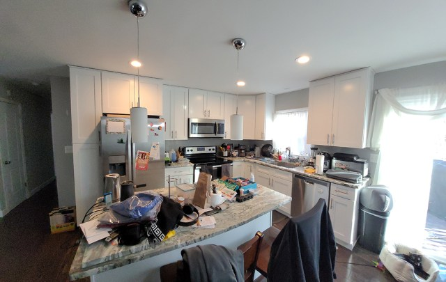 Full view of kitchen with unpainted cabinets