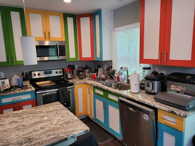 Side view of kitchen with painted cabinets